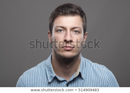 Stock photo: Handsome young man close-up portrait (toned in blue)