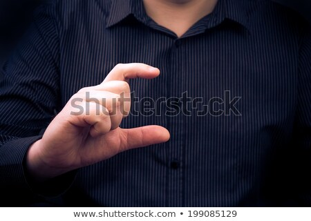 man hand holding gadget showing size something stock photo © fotoaloja