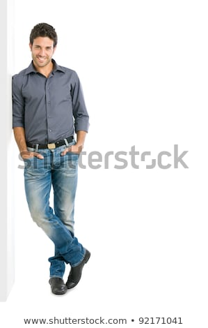 Fashion man leaning on a white wall  Stock photo © feedough