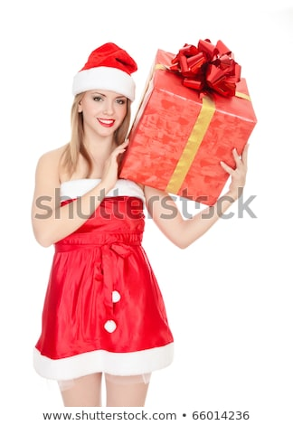 Cheerful santa helper girl with big gift box on her shoulder Stock photo © Nobilior