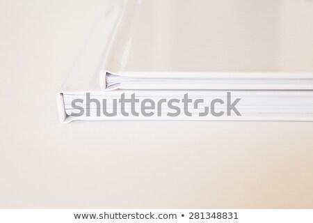 Aligned white photo books details Stock photo © talitanicolielo