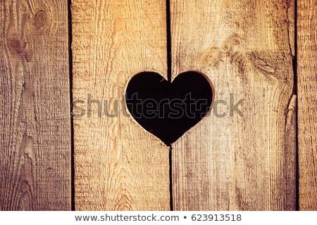 Heart On A Wood Board Stock photo © olgaaltunina