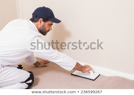 Handyman laying down a carpet Stock photo © wavebreak_media