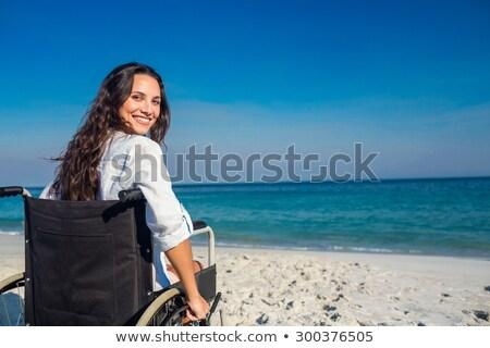 инвалидов женщину глядя камеры морем Сток-фото © wavebreak_media