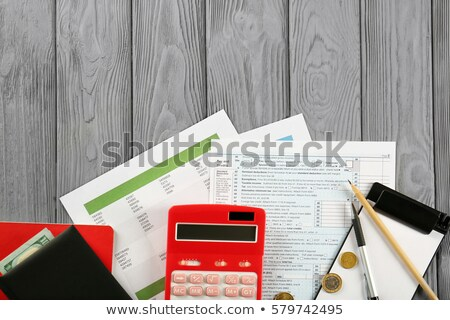 Bills and calculator on table Stock photo © wavebreak_media