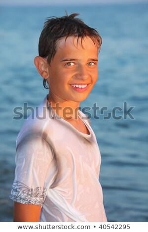 teenager boy in wet clothes on seacoast Stock photo © Paha_L