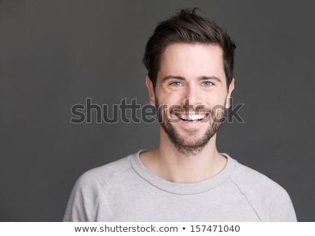 Man with Beard Smiling Joyfully in Studio Stock photo © ozgur