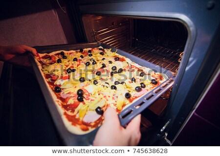 Pizza dough and tomato puree Stock photo © Digifoodstock