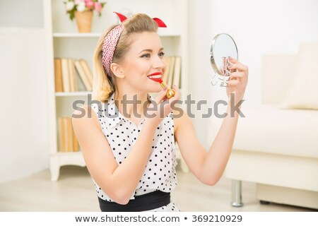 Stunned pin-up girl Stock photo © alphaspirit