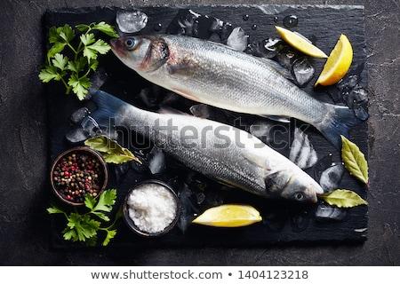 Deux fraîches mer basse poissons blanche Photo stock © Digifoodstock