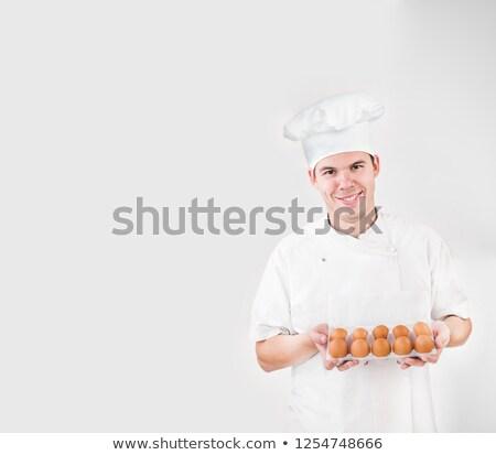 Weiß Eier Feld isoliert menschlichen Hand halten Stock foto © zurijeta
