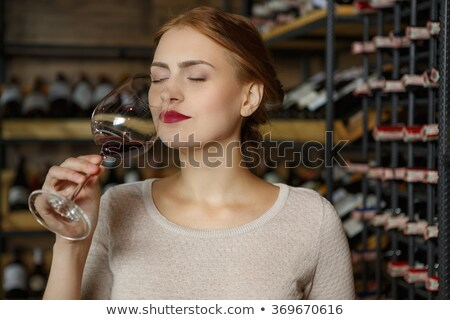 Young woman smells bottle of wine Stock photo © Giulio_Fornasar