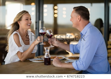 Happy couple toasting wine glass while having meal Stock photo © wavebreak_media