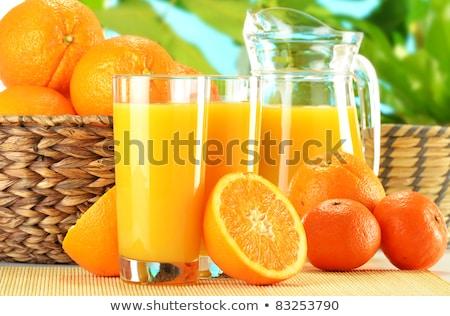 Jarra frescos jugo de naranja blanco jugo líquido Foto stock © Digifoodstock