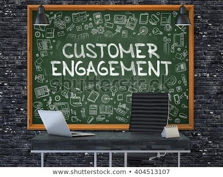 customer engagement on chalkboard with doodle icons stock photo © tashatuvango