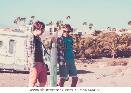 Young couple prepare to go surfing Stock photo © IS2
