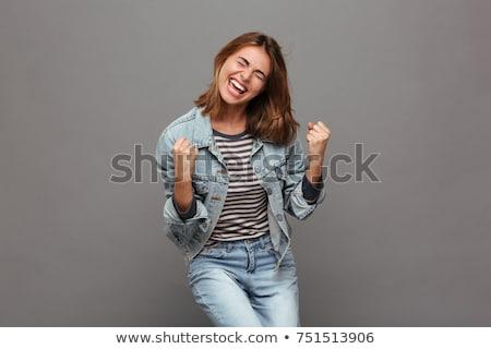 mutlu · genç · kadın · zafer · yalıtılmış · arka · plan - stok fotoğraf © dolgachov