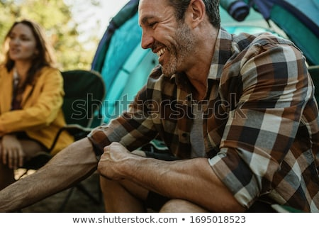 Women sitting at campsite in forest Stock photo © IS2