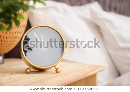 bed and bedside alarm clock in the bedroom Stock photo © adrenalina