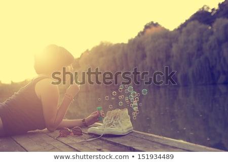 Lány buborékfújás tó jókedv tiszta ötlet Stock fotó © IS2