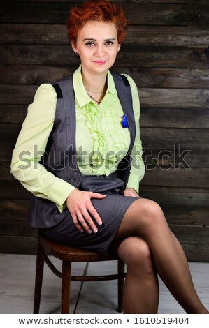 pensive attractive businesswoman sits on wooden chair Stock photo © feedough