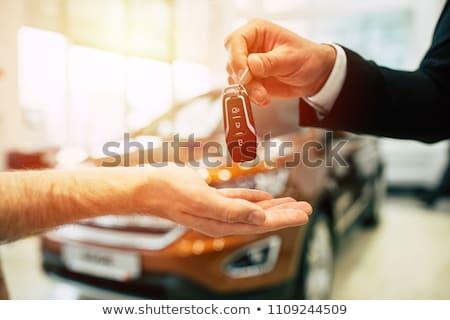 Young man hand over keys  Stock photo © ra2studio