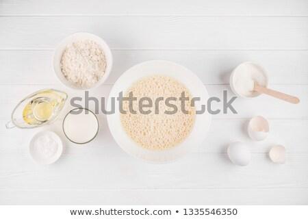 Kellékek hozzávaló körül tál tojássárgája közelkép Stock fotó © dash