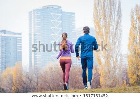 Coppia jogging colorato fogliame dietro esecuzione Foto d'archivio © Kzenon