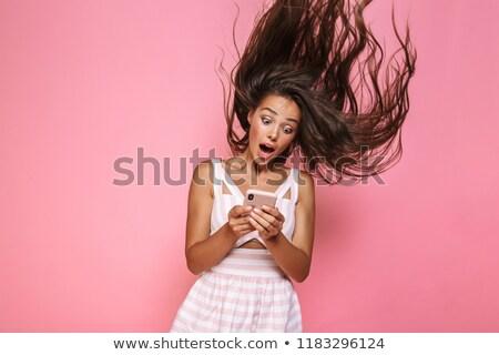 Foto extático mulher 20s vestir Foto stock © deandrobot