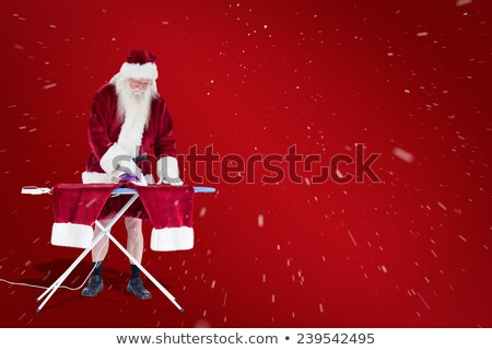 portrait of santa claus looking down at white board stock photo © feedough