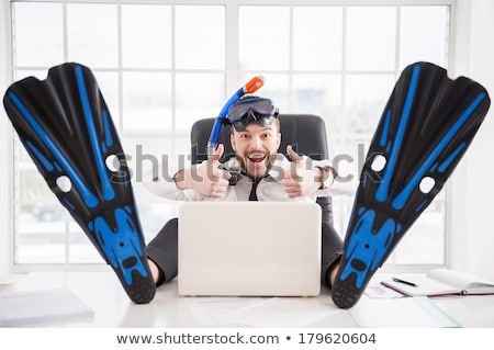 Businessman ready to travel works with his laptop Stock photo © alphaspirit