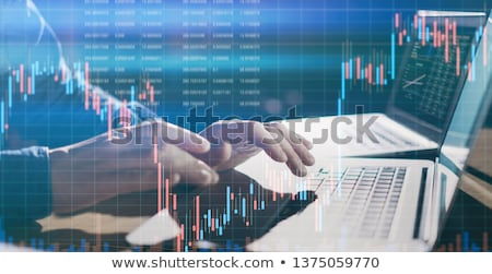 Investor analyzing financial reports of stock trading Market Gra Stock photo © snowing