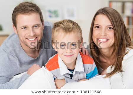 A Father and his five years kid on the sofa at home Stock photo © Lopolo