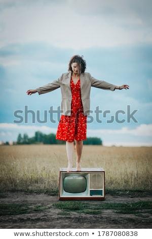 Portrait of beautiful woman with strait hair. Walking in sunflower field. stock photo © ElenaBatkova