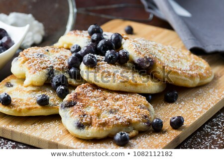 Pancakes with blueberries on the plate. Traditional breakfast Stock photo © LoopAll