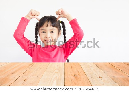 Girl Looking At Person's Hand Pointing On Her Stock photo © AndreyPopov