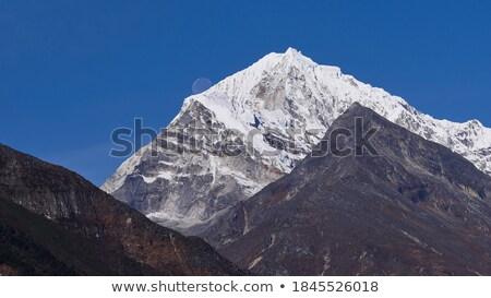 Three peaks mountain at daylight Stock photo © frimufilms