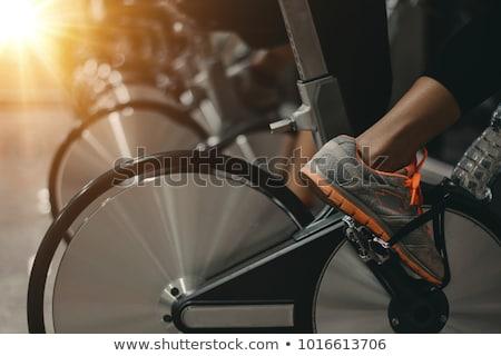 Insanlar bisiklete binme spor salonu aktif egzersiz bisiklet Stok fotoğraf © Kzenon