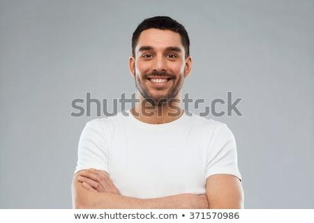 férfi · póló · mutat · középső · ujj - stock fotó © dolgachov