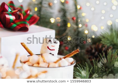 Snowman Soaking in a Cup of Hot Cocoa and Marshmallows Stock photo © StephanieFrey