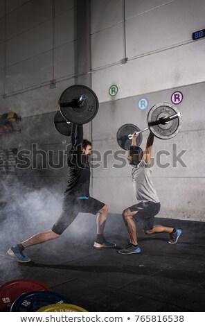 два конкурентоспособный молодым человеком весов спортзал Сток-фото © Kzenon