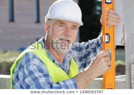 Muratore spirito livello uomo costruzione Foto d'archivio © photography33