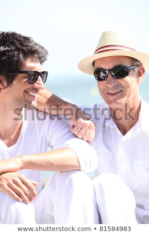 Father and son basking under the sunlight together Stock photo © photography33