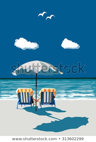 Couple sitting in chairs at the edge of the beach Stock photo © photography33