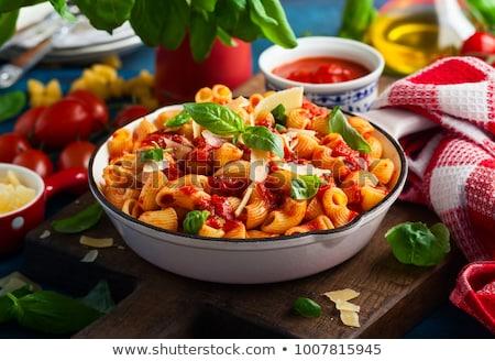 tomato macaroni and green basil stock photo © elmiko