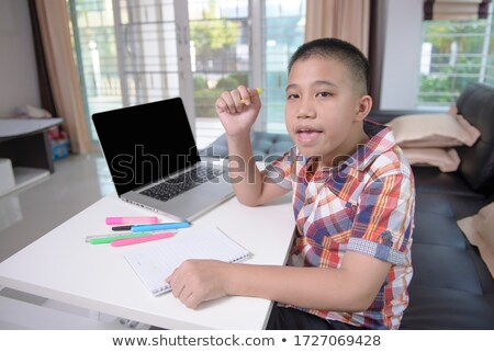 Teacher correcting his student's homework Stock photo © photography33