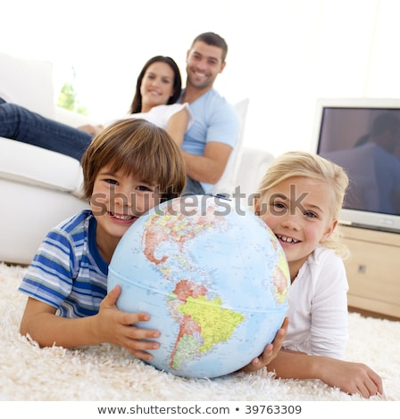 happy family looking terrestrial globe Stock photo © photography33