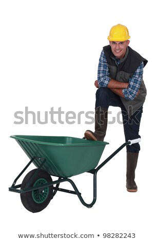 Tradesman with his foot propped on a wheelbarrow Stock photo © photography33