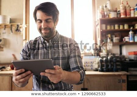 Tradesman sitting on a workbench Stock photo © photography33
