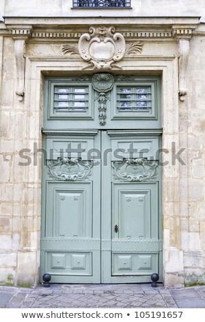Old Wooden Door Seen In Paris France Stok fotoğraf © haraldmuc